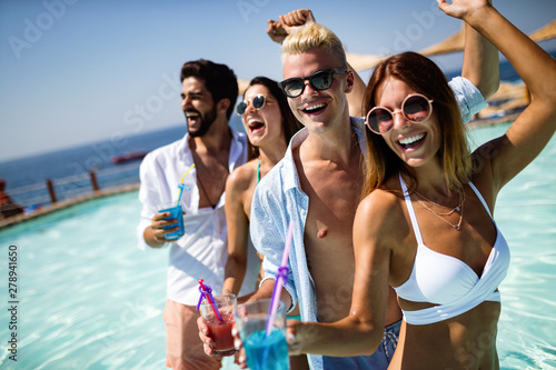 Summer party. Friends at beach drinking coctails and having fun - 278941650