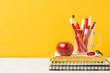 Warm colors school supplies front view