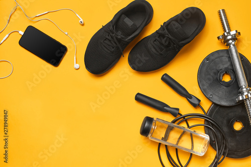 Close-up studio shot of a gym accessories on a yellow background Wallpaper Mural