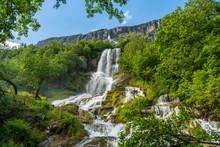 Beautiful Waterfall Flushing Down A Mountainside In Norway