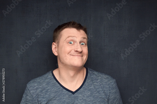 Portrait of surprised man looking genially at camera Canvas Print