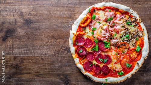Fotografie, Obraz  Pizza Four Seasons with Mozzarella cheese, ham, tomato sauce, salami, bacon, mushroom, pepper, Spices and Fresh basil