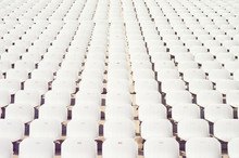 Rows Of Empty White Plastic Se...