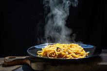 The Steam From Spaghetti Carbonara Pasta. Spaghetti With Pancetta, Egg, Parmesan Cheese And Cream Sauce. Traditional Italian Cuisine - Homemade Healthy Pasta On Dark Background. Hot Food Concept