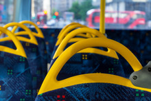 Inside A Double Decker Bus Empty Seats. Interior With Yellow And Blue Chairs And Seats.