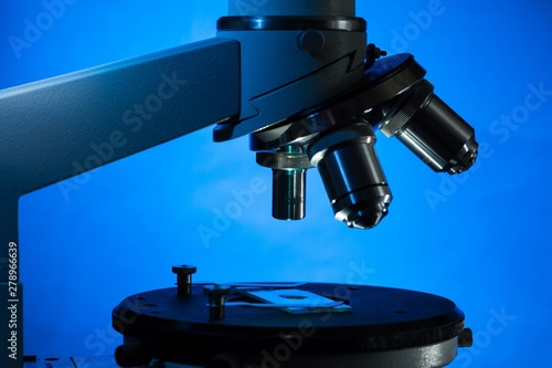 Closeup of Microscope Lenses and Slide