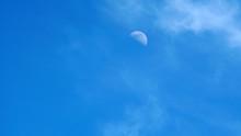 Moon On A Blue Sky Day