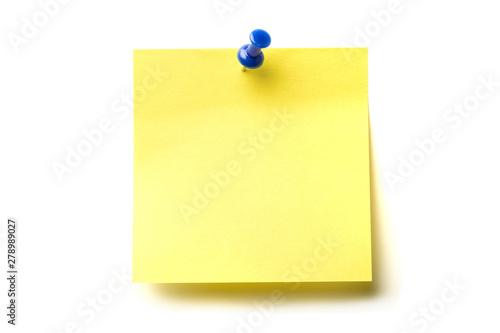 Posit de color amarillo y marcador azul clavado sobre fondo blanco Canvas Print