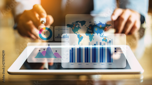 Fotomural  Businessman investment consultant analyzing company financial report balance statement working with digital augmented reality graphics