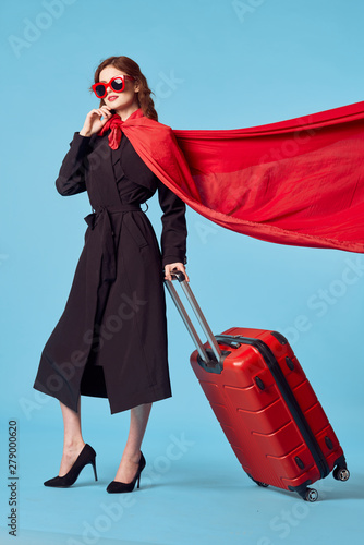 young woman with suitcase Wallpaper Mural