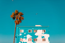 Apartment Building With Peeling Turquoise Paint