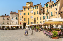 Amphitheater Square With Restaurants, Bars And Tourists In Old Town Lucca, Tuscany, Italy