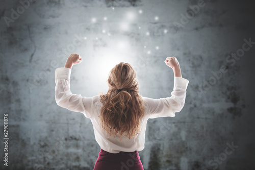 businesswoman with expression of success on abstract background