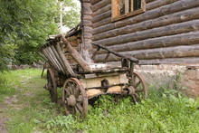 An Old Wooden Cart With Wooden...