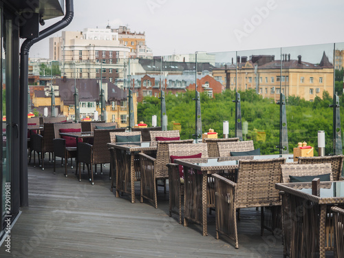 Sky cafe on the roof terrace with view of modern city Wallpaper Mural