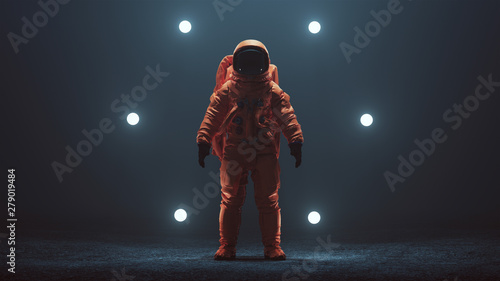 Photo sur Toile Bleu nuit Astronaut in an Orange Space Suit with Black Visor Standing in a Alien Void 3d illustration 3d render