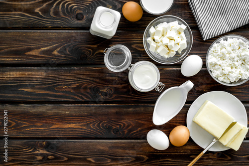 Poster Dairy products Dairy products from farm with milk, eggs, cottage, butter, yougurt on wooden background top view mockup