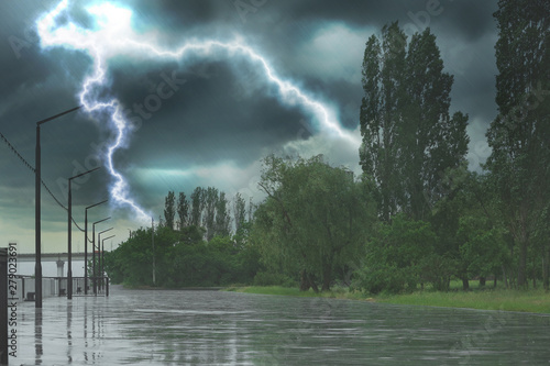 Fotografía Empty city embankment under heavy rain with lightnings