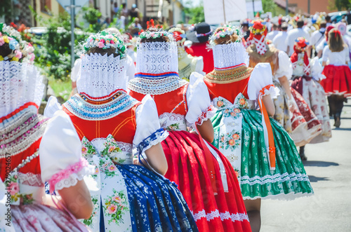 Vászonkép Young women during parade in traditional Czech folklore costumes
