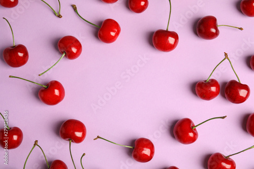 Foto auf Leinwand Kirschblüte Flat lay composition with sweet cherries on lilac background. Space for text