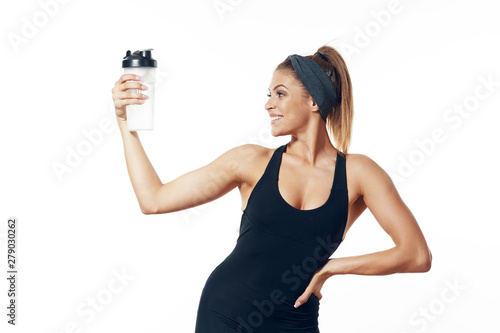 Fotografia  young woman with bottle of water isolated on white