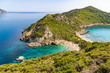 Famous two side Porto Timoni beach near Agios Georgios. Crystal clear azure water. Corfu, Greece