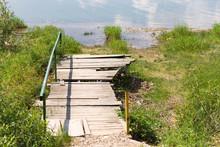 Zywieckie Lake. A Broken Bridges On The Lake In Poland. Rotten Wood Flooring.