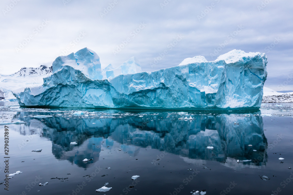 Fototapety, obrazy: Impressive iceberg with blue ice and beautiful reflection on water in Antarctica, scenic landscape in Antarctic Peninsula