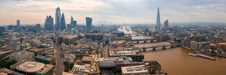 Aerial panoramic view of the London city district with many modern glass skyscrapers in the city center. United Kingdom.