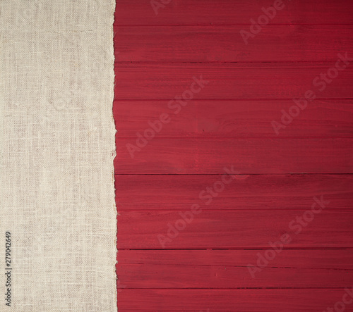 Rustic Red Wood Boards in Flat layout with off white Burlap fabric on side as decorative design element.  It's horizontal but works as vertical and has copy space.