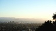 Sun setting over San Francisco and the Golden Gate Bridge on a clear Summer night, fog rolling into the Bay from the Pacific Ocean. Seen from Berkeley Hills, California.