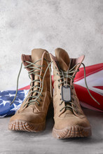 Military Boots And USA Flag On Table