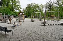 Children's Wooden Jungle Gym And Playground On Gravel Sand.
