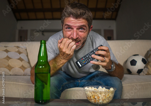 excited football supporter man watching soccer game on television at home sofa c Fototapet
