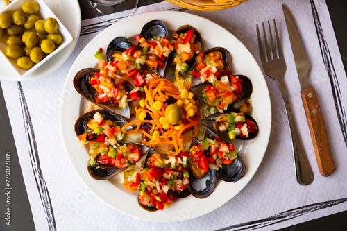 Delicious mussels served with vinaigrette from vegetables