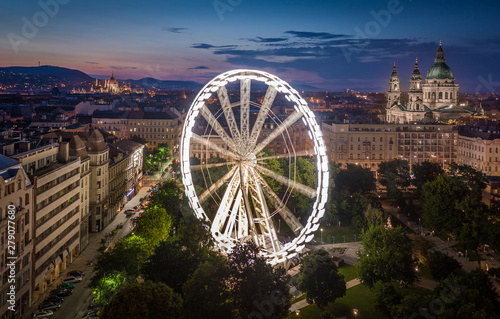 Foto auf AluDibond Budapest Budapest, Hungary - Aerial view of Elisabeth square at dusk with illuminated ferris wheel, St. Stephen's Basilica and Hungarian Parliament building at background. Summer evening in Budapest