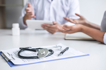 Doctor consulting with patient and checking sickness condition while presenting results diagnosis symptom examining about the problem of illness and recommend treatment method, Healthcare and medical