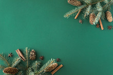 Christmas Green Background With Fir Tree And Cones, Cinnamon, Anise. Flat Lay, Top View With Copy Space