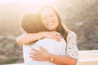 canvas print picture - Love and friendship concept twith couple of women young friends hugging and smiling with love - diversity for caucasian people - alternative love - sun in backlight with light effect