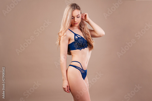 Photo Stands Akt Beautiful blonde woman with a perfect body in lingerie
