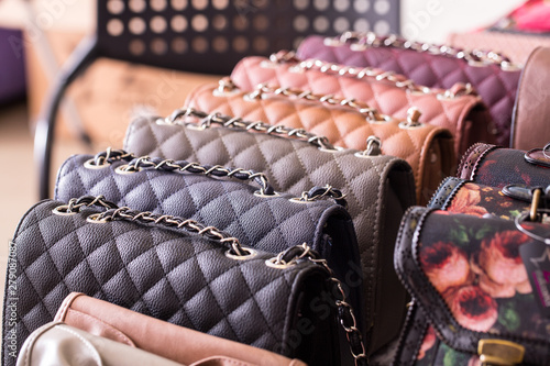 Stylish and trendy leather handbags are seen closeup on the shelf inside a fashion store Canvas Print