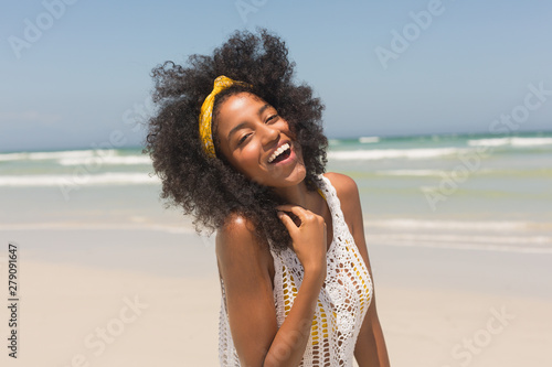 Young African American woman looking at camera on the beach