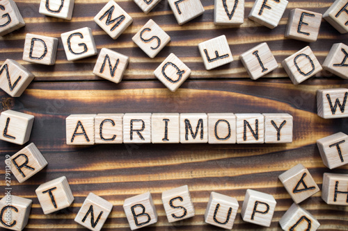 acrimony wooden cubes with letters, bitter full of anger concept, around the cub Canvas Print