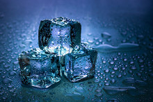 Ice Cubes And Water Melt On Co...