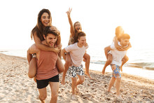 Group Of Cheerful Happy Young Friends Having Fun