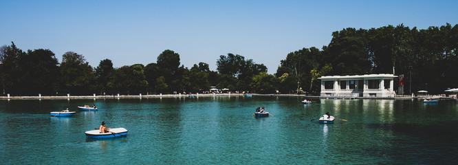 Fototapeta na wymiar Madrid 2018 - People in boats in a lake in a public park