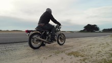 Low Aerial Of Motorcyclist Kic...