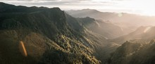 Beautiful Panoramic Shot Of Mountains And Rocky Cliffs And Natural Fog
