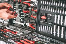 Hardware Showcase. Cropped Shot Of Repairman Choosing Screwdriver In Tool Store.