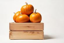 Ripe Orange Pumpkins In A Wooden Box